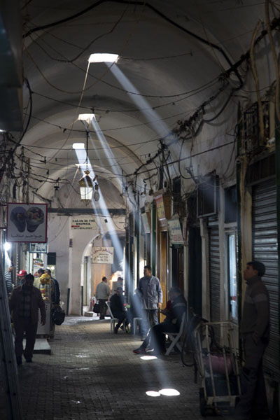 Foto van Rays of sunlight shining through skylights on the covered souq of TunisTunis - Tunesië