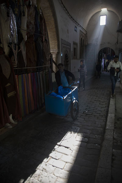 Foto van Rays of light shining inside one of the streets of the covered souq of TunisTunis - Tunesië