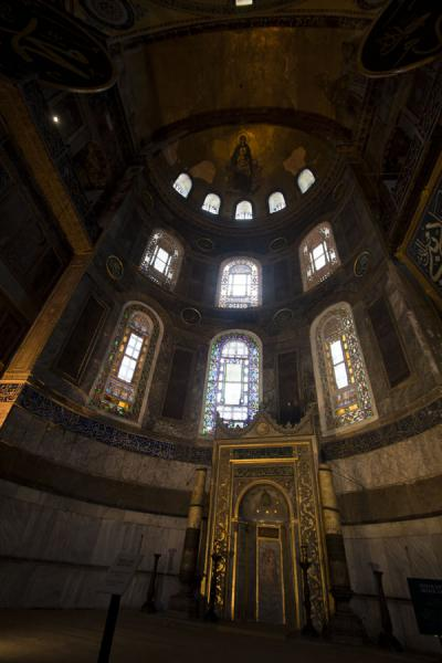 Picture of Mihrab where the altar once stood, with stained glass windows, and mosaic of Virgin Mary and child in the dome
