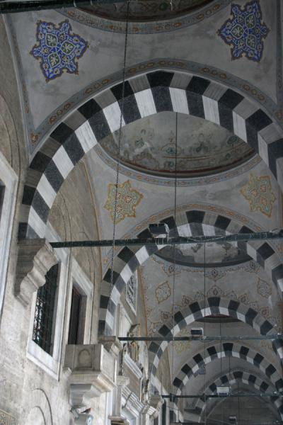 Colourful high arches hold the roof of the mosque of Eyüp | Eyüp Sultan Mosque | Turkey