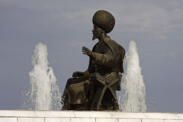 Picture of Independence Park (Turkmenistan): Statue of famous Turkmen poet Kemine at the base of the Independence monument