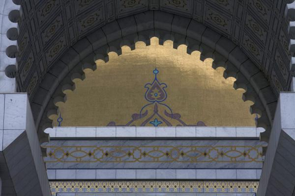 Part of the golden dome seen through the entrance gate | Turkmenbashy Ruhy Mosque | Turkmenistan