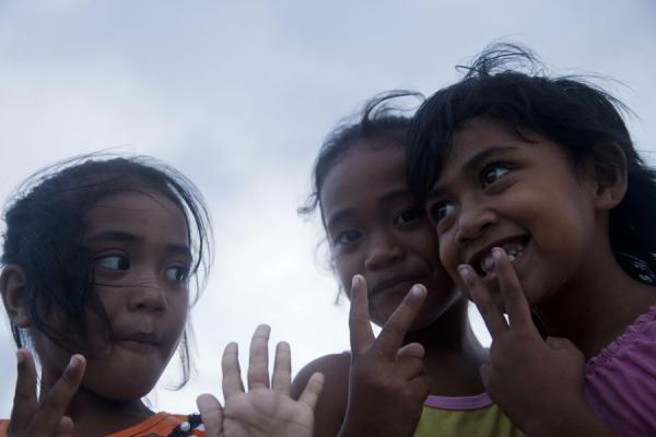 Three girls having fun with the camera | Tuvaluan people | Tuvalu