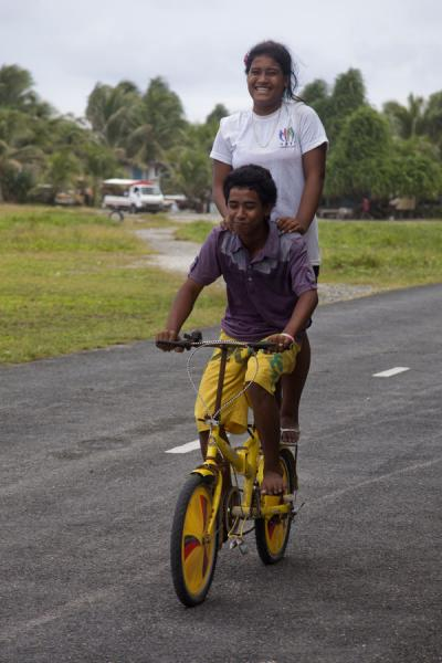 Picture of Tuvaluan kids on a bike near the runwayTuvalu - Tuvalu