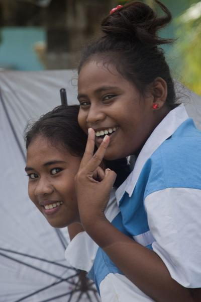 Tuvaluan girls in school uniform posing for a picture | Tuvaluan people | Tuvalu
