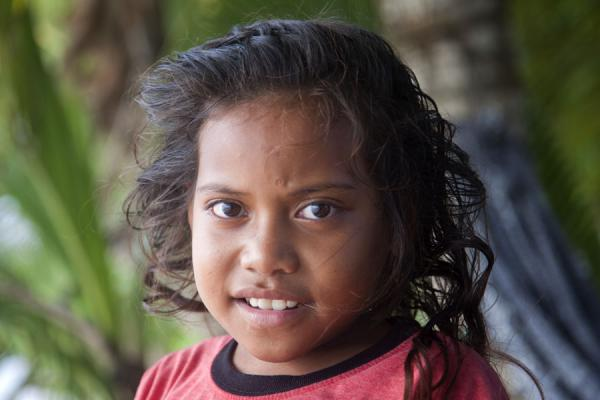 Young Tuvaluan girl under palm trees | Tuvaluani | Tuvalu