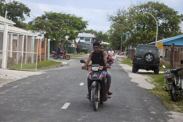 Tuvaluans on a scooter in one of the streets of Vaiaku town | Tuvaluani | Tuvalu