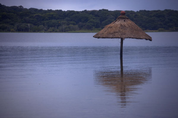 Picture of Buggala Ssese Island (Uganda): Lutoboka Bay with straw parasol in the water