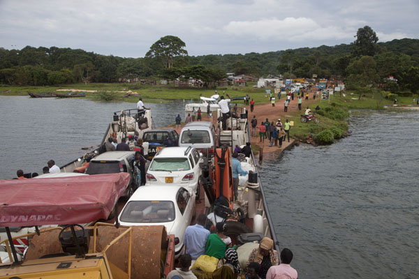 Foto de The ferry from Entebbe just arriving at the pier on Buggala IslandBuggals - Uganda