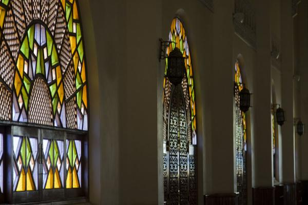 Picture of Gadhafi National Mosque (Uganda): Brightly coloured stained glass windows and lanterns in the main prayer hall