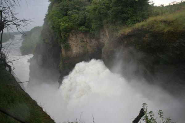 Water being hurled up in the air through the gorge of Murchison Falls | Murchison Falls | Uganda
