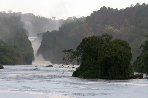 The falls seen from a distance, with island in the river Nile | Murchison Falls | Uganda