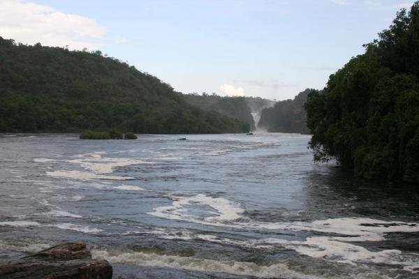 River Nile with foam caused by the force of Murchison Falls in the background | Murchison Falls | Uganda