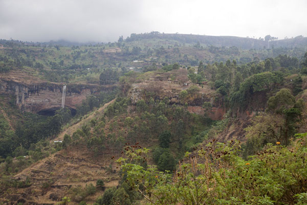 Overview of the landscape at Sipi with the third waterfall on the left, and the first in the far right | Sipi Falls |