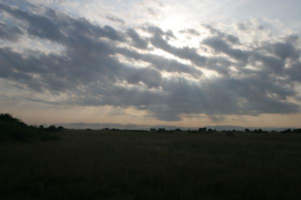 Morning sun breaking through the sky over Queen Elizabeth National Park | Uganda Light | Uganda