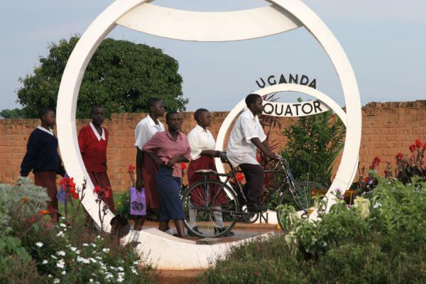 Young Ugandans passing the equator sign on their daily routine | Uganda people | Uganda