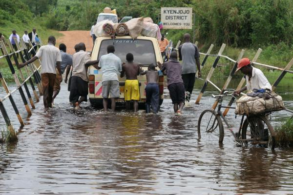 Struggling to get a car across a flooded bridge | Uganda people | Uganda