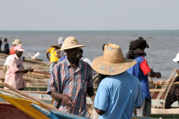 Fishermen adjusting their nets on the shore of Lake Edward | Uganda people | Uganda