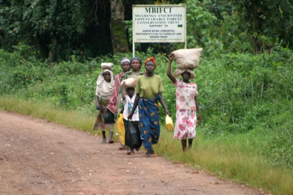 People walking alongside a road in Uganda, a common sight | Uganda people | Uganda
