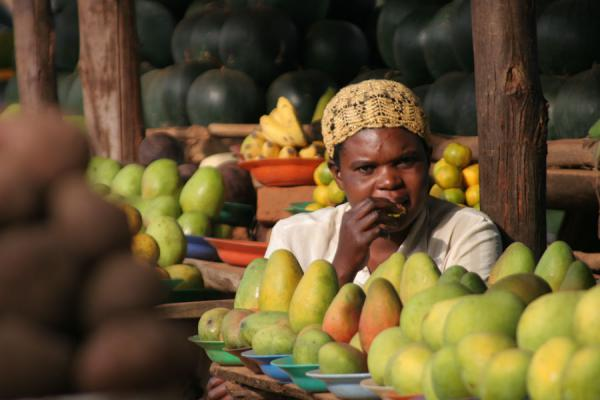 Woman selling fruits and tasting some herself | Uganda people | Uganda