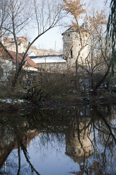 View across Smotrych river with Ruska gate in the distance | Kamyanets-Podilsky old town | Ukraine