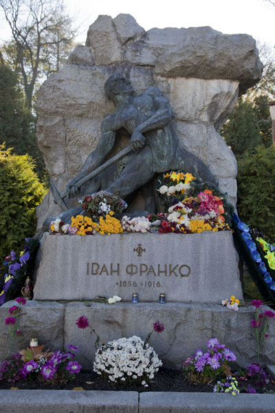 Poet Ivan Franko is glorified with this sculpture and grave, and still receives plenty of flowers | Lychakiv cemetery | Ukraine