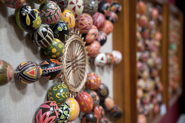 Side view of several figures with painted easter eggs | Pysanka Museum | Ukraine
