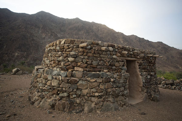 Picture of Al-Hayl Fort (United Arab Emirates): Oval stone building at the foot of Al-Hayl Fort
