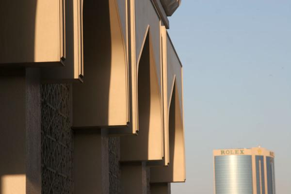 Picture of Dubai modern architecture (United Arab Emirates): Arched facade of mosque with modern skyscraper in the background