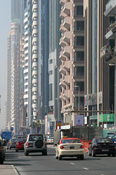 Picture of Dubai modern architecture (United Arab Emirates): Sheikh Zayed Road with cars dwarfed by modern architecture