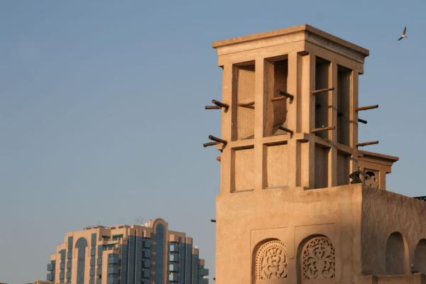 Traditional Windtower With Modern Building In The Background Dubai