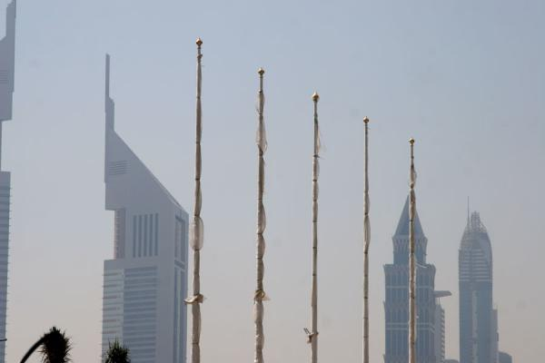 Picture of Dubai modern architecture (United Arab Emirates): Skyscrapers and flagpoles on Sheikh Zayed Road