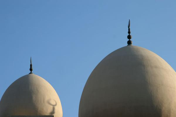 Picture of Dubai mosques (United Arab Emirates): Domes of the Grand Mosque in Bur Dubai with setting sun
