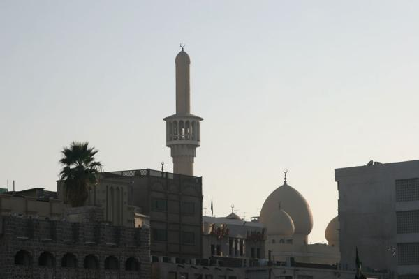 Picture of Dubai mosques (United Arab Emirates): Minaret and cupola just before sunset in Bur Dubai