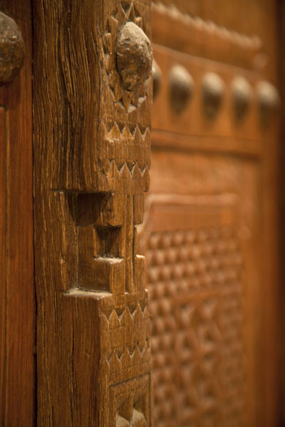 Close-up of a decorated wooden door | Dubai Museum | United Arab Emirates