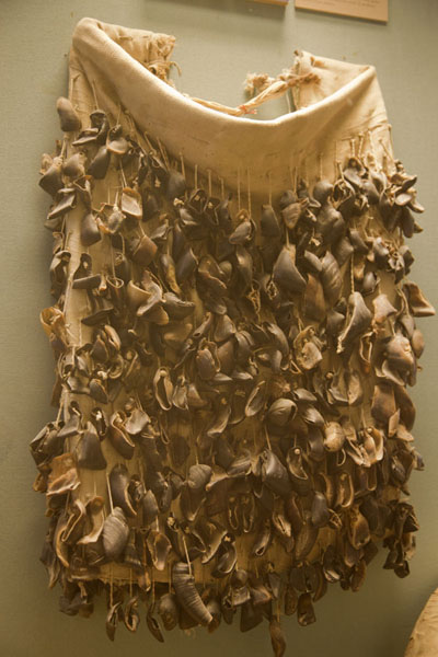 Skirt with goat hooves used to make music by swinging the hips | Dubai Museum | United Arab Emirates