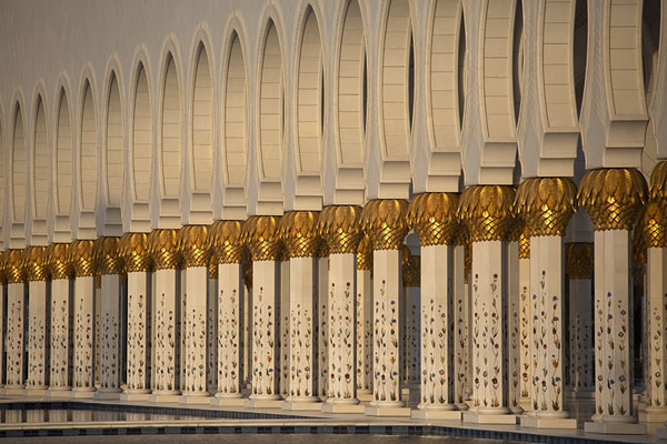 Row of arches and columns on the west side of the Grand Mosque of Sheikh Zayed | Sheikh Zayed Grand Mosque | United Arab Emirates