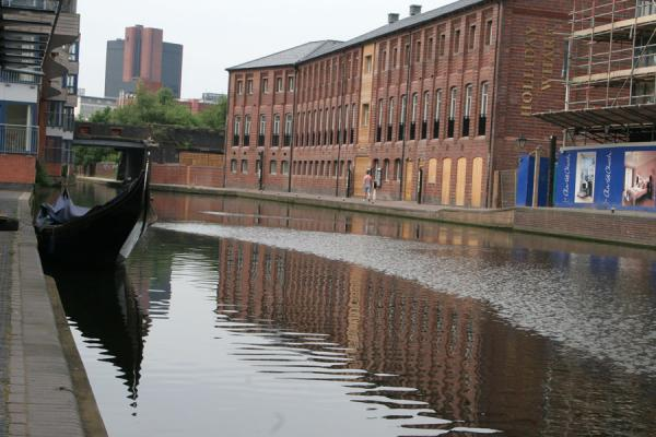 Canal with new development and gondola near the Mailbox | Birmingham Canals | United Kingdom