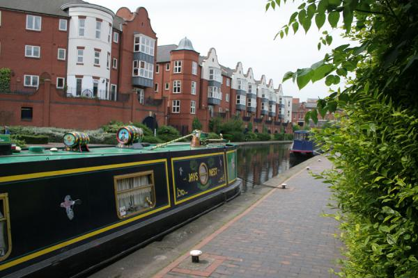 One of the narrowboats and new houses in the background | Birmingham Canals | United Kingdom