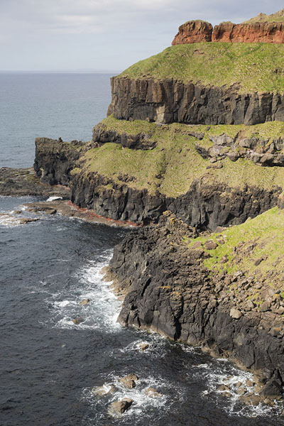 Picture of Giant's Causeway (United Kingdom): The rocky shoreline east of the Giant's Causeway with Lacada Point on the left