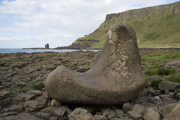 Picture of The Boot lying on the stony coastline near the Giant's Causeway