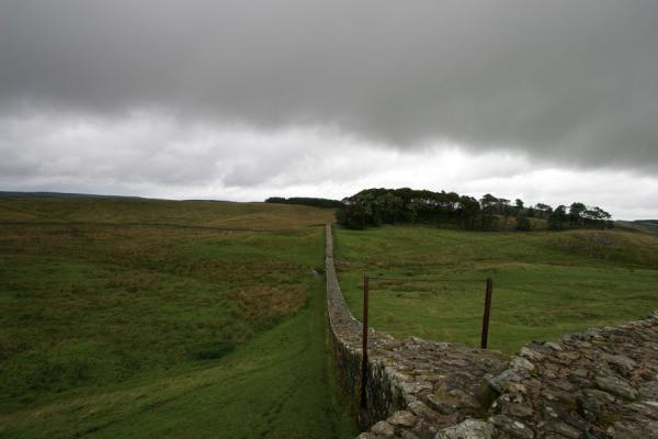 Picture of Hadrian's Wall (United Kingdom): Hadrian's Wall in a green landscape under a dark grey sky