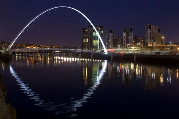 White arch of the Gateshead Millennium Bridge reflected in the Tyne river | Newcastle Bridges | United Kingdom