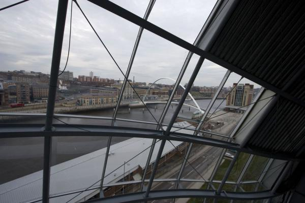 Looking through the windows of the Sage Gateshead with Gateshead Millennium Bridge | Sage Gateshead | United Kingdom