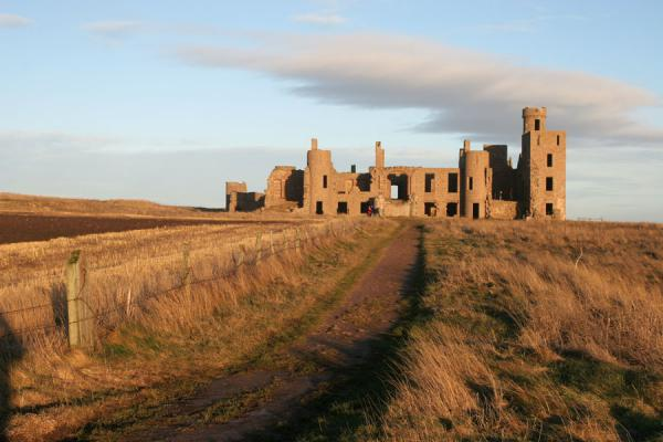 Path leading up to Slains Castle with some of the landscape | Slains Castle | United Kingdom
