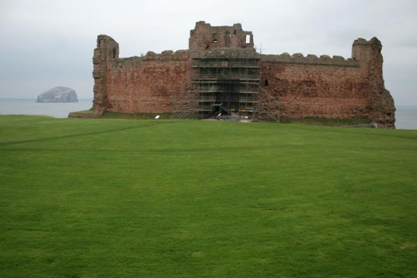 Picture of Tantallon Castle (United Kingdom): Bass Rock appearing behind Tantallon Castle