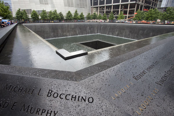 Looking at the South Pool: names of victims in the foreground, the waterfall and the Memorial Pool | 9/11 Memorial | U.S.A.