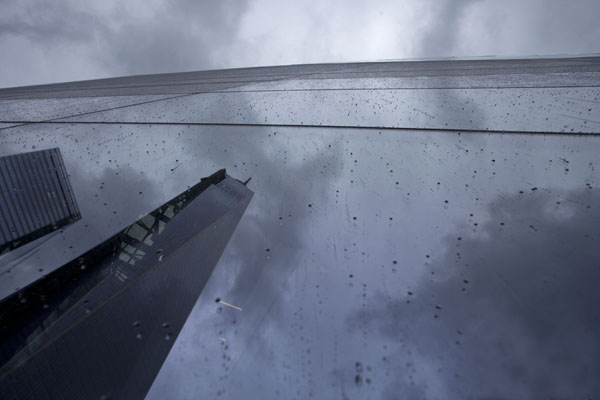 Picture of 9/11 Memorial (U.S.A.): Windows of the museum reflecting the Freedom Tower