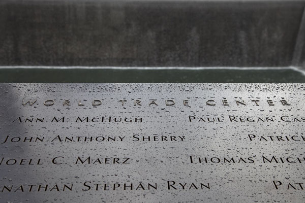 Some of the names of the victims of the 9/11 attacks around the South Pool | 9/11 Memorial | U.S.A.
