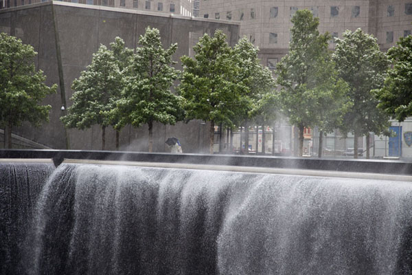 Picture of 9/11 Memorial (U.S.A.): Waterfall of the North Pool with wind blowing the water around
